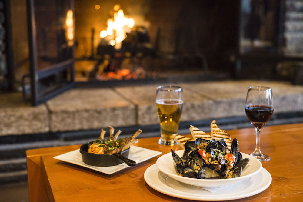 Duck Wings and the Mussels from our Après Ski menu in front of our wood-burning fireplace
